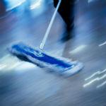 Sugar Land janitorial company worker dusting floor