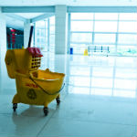 Houston office cleaning services mop bucket on cleaned flooor