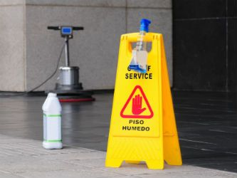 Cleaning services Houston wet floor caution sign